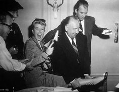 "Doris Day, Alfred Hitchcock and James Stewart celebrating Day's birthday on the set of ""The Man Who Knew Too Much""."