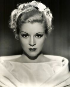 Claire Trevor - lover her hair (and eye make-up) here.1930s actress