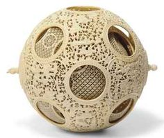 Chinese puzzle balls are ornate decorative items that consist of several concentric spheres, each of which rotates freely, carved from the same piece of material. Although the master carvers of old. China, Puzzle, Bone Carving, Shell, Chinese Art, Decorative Items, Sculptures, At Least, Stone