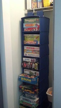 Use hanging cloth shelves in your kid's toy closet to store board games.
