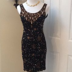 Gorgeous cocktail/evening dress This is a beautifully detailed dress with exquisite sequence and beading. The base of the dress is black with gold, bronze & blue accents. Worn once. Perfect condition. Made of 100 percent silk with rayon lining. Together Dresses