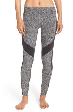 Stretchy space-dyed leggings feature mesh insets at the sides as well as bold black contrast paneling for a chic workout look.