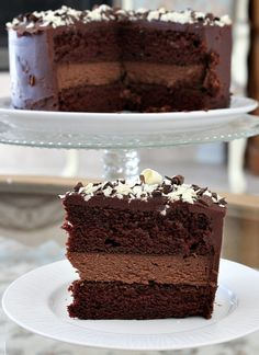 Chocolate Cheesecake Cake Recipe:  Two layers of rich chocolate cake with a layer of chocolate cheesecake in the middle... all topped with dark chocolate frosting!