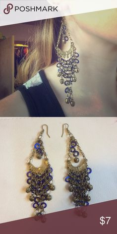 Brass and blue bell earrings These fun chandelier earrings are a brass color, and decorated with blue circles and tiny bells. Great for a relaxed bohemian look and sure to attract a lot of attention! These were bought at the 2015 Renaissance Faire. Jewelry Earrings