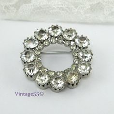 Vintage Brooch Rhinestone clear circle style. $12.00, via Etsy.