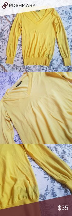 NWOT Canary Yellow Club Monaco V Neck Sweater This has never been worn, which is a shame because it's so darn cute. It's too big on me and too bright for my wardrobe. It is a lightweight v neck, perfect for the summer. There are no signs of wear. Some knit detailing around the collar and shoulders as pictured. Club Monaco Sweaters V-Necks