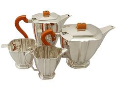 Sterling Silver Four Piece Tea and Coffee Service - Art Deco Style - Antique George V  SKU: A5324 Price: GBP £1,995.00  http://www.acsilver.co.uk/shop/pc/Sterling-Silver-Four-Piece-Tea-and-Coffee-Service-Art-Deco-Style-Antique-George-V-67p8860.htm