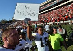 Georgia Tech defensive back A.J. Gray (15) holds a sign to celebrate their 28-27 win over Georgia at Sanford Stadium on Saturday, November 26, 2016. HYOSUB SHIN / HSHIN@AJC.COM