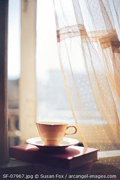 © Susan Fox / Arcangel Images - Window, teacup, book, lace curtains