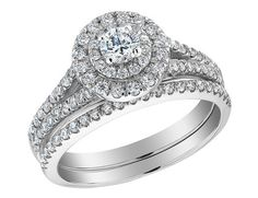 The majesty and brilliance of the diamond jewel is beautifully showcased in this gorgeous 1.0 carat (ctw) wedding band and engagement ring set. The engagement ring features a sparkling diamond surrounded by two twinkling haloes for a glamorous and unique result. Both rings are then adorned by more diamonds down the sides of the 14 karat white gold bands. This ring set is independently certified. View item video above.