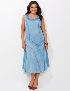 Our striking dress features intricate embroidery within its asymmetrical panel design. The patches of flourishing threads, scalloped edges and angled panels create a memorable look. Scoop neckline. Back button keyhole closure. Princess seams. Catherines dresses are expertly designed for the plus size woman. catherines.com