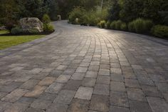A curving driveway with Roman pavers showcase a classic look. Precast Concrete, Classic Looks, Rome, Sidewalk, Driveways, Front Yards, Rustic, Green, Classy Looks