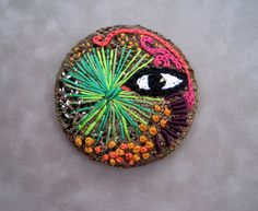 """Freeform embroidery on recycled fabric over a recycled metal 3.5"""" pinback button"""