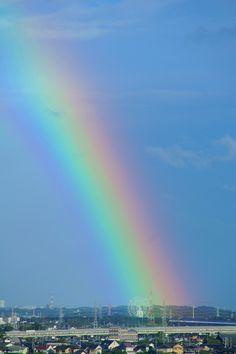 A rainbow over a big wheel