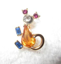 On auction, the faberge inspired mouse pin. This is the actual pin worn by Joan Rivers--from her personal jewel box. It could be yours...