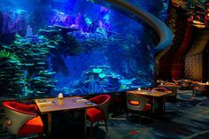 Outlaw's at Al Mahara is located on the lower level of the iconic Burj Al Arab. Like Atrium Bar, this restaurant isn't underwater but instead features a remarkable aquarium centerpiece.