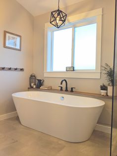 Master Bathroom This freestanding bathtub replaced the old, unused jetted bathtub. It opens the room Bathroom Renos, Small Bathroom, Bathroom Ideas, Master Bathroom Tub, Master Bathtub Ideas, White Bathrooms, Luxury Bathrooms, Budget Bathroom, Dream Bathrooms