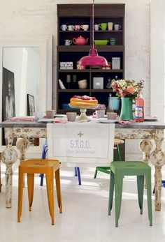 Colorful modern & metal chairs with vintage distressed table