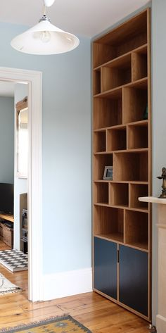 fitted bookcase for wall recess next to the chimney breast