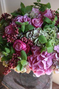 purples and greens floral arrangement