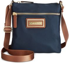 $57, Navy Canvas Crossbody Bag: Calvin Klein Nylon Crossbody. Sold by Macy's. Click for more info: https://lookastic.com/women/shop_items/249092/redirect