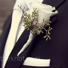 Boutonnieres of white roses and tiny berries made a classic addition to the guys' lapels.