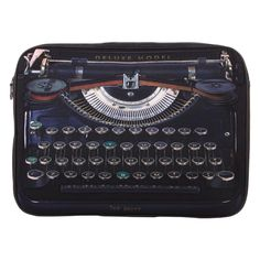 Ted Baker - Typewriter Laptop Sleeve. I do like the juxtaposition of old technology concealing new.