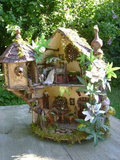 I believe in fairies, and believe every garden should have fairy homes placed amongst your plants so the fairies know your garden is safe....this would make a great fairy house :D