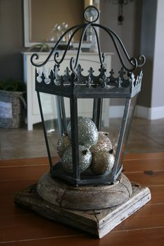 Willow House Monarch Lantern with pottery barn glitter easter eggs.