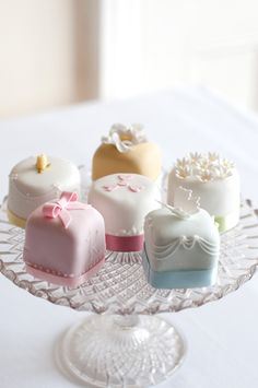 Little petite fours resembling wedding cakes as treats at each table for the reception or favors - Love this idea!