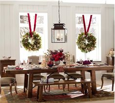 Window wreaths with red ribbon