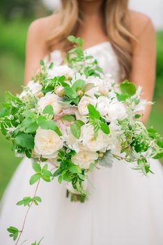 beautiful flowers. maybe too much greenery? love the small rosebuds