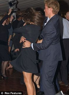 Dancing together at a university gala in their first appearance after their relationship became public