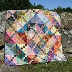 """Looking for a way to use up your scraps? The Bermuda Sunrise Quilt Pattern is a perfect way to start BASHING THAT STASH!!! This is a great pattern for batiks or for any fabrics that almost read as a solid. Finished Size: 54"""" x 54"""" (Throw or Lap Quilt, Wall Hanging)"""