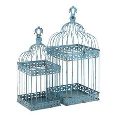 Les oiseaux ne sont plus en cage ! Disposez des bougies dans ces deux lanternes en métal au style original pour créer une atmosphère romantique.