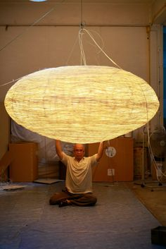 Production of a custom made gigantic hanging lamp - made out of several miles (!!) of thin split rattan. Holding the final piece! www.udogangl.com Ceiling Lamp, Ceiling Lights, Rattan, Chandelier, Lighting, Design, Home Decor, Wicker, Homemade Home Decor