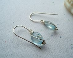Wire-wrapped earrings - I like how the wrap up the bead so that it looks like it is part of the pattern