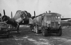 Ground personnel of the Bomb Group refuel a Flying Fortress (serial number nicknamed Yankee Doodle. refueller of 8 Group Bomber Command Left- American Ford light sedan 5 passenger- US Army had of 1942 mould alone. Ww2 Aircraft, Military Aircraft, Ww2 Planes, Military Equipment, Toyota Supra, World War Two, Military Vehicles, Wwii, Aviation
