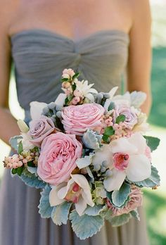 : Blush Grey theme pink roses white cynbidium orchids with a pink center dusty miller, beautiful bouquet. /