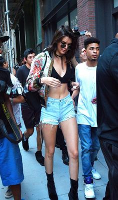 Kendall Jenner elevates her crop top and shorts combo with a printed bomber jacket