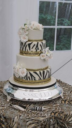 Kate's African Theme Wedding Cake Zebra print, gumpaste roses and orchids African Wedding Cakes, Round Wedding Cakes, Wedding Cake Photos, Themed Wedding Cakes, Themed Cakes, African Cake, African Theme, Traditional Wedding Cakes, Traditional Cakes