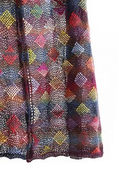 Polychromatic is a soft, light, colorful shawl with colored diamonds set in an airy openwork mesh. The pattern is inspired by Schoppel-Wolle's Zauberball colors and the paintings of Paul Klee - the colorwork diamonds look like flickering little brushstrokes.