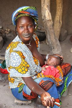 Fulani woman feeding her baby