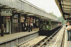"""A Sprague Metro Train at Barbès-Rochechouart Green carriages are second class the red for first class. Metro Subway, Nyc Subway, Old Paris, Vintage Paris, Paris Metro, U Bahn, Paris Ville, Busse, London Underground"