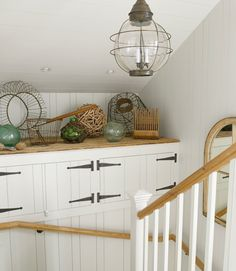 Love the idea of displaying favorite  antiques and collections on a stairway landing.