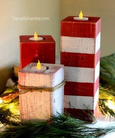 Made using a 4x—4 post cut into 3 pieces, frog tape, a drill, and 1 1/2 inch spade bit, sander, and twine, these peppermint candlesticks will freshen up your tablescape this holiday season.