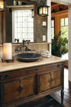 Great bathroom OK I love everything about this. I love the color scheme, wood vanity with the light countertop and vintage look faucets.