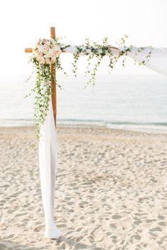 Delightful wedding canopy with floral decoration for beach wedding in Crete. Moments www.weddingincrete.com