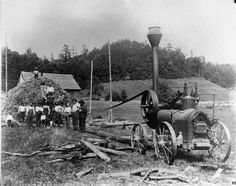 Men running a portable steam engine on farm near Huntersville, West Virginia. Circa 1905. From the Pocahontas County W. Va. Historic Preservation Archive.