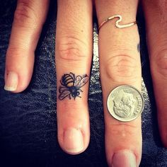 Tiny Bee Finger Tattoo - Devin Mena - Laguna Tattoo i would get a flower. really cute!